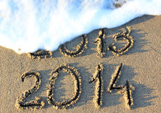 Happy New Year. 2014 replace 2013 concept on the sea beach Royalty Free Stock Images