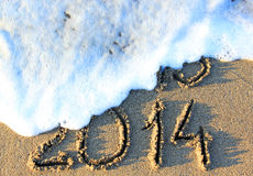 Happy New Year. 2014 replace 2013 concept on the sea beach Royalty Free Stock Photo