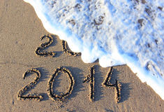 Happy New Year. 2014 replace 2013 concept on the sea beach Stock Photos