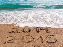 Happy New Year 2015 . Happy New Year 2015 replace 2014 concept on the sea beach Stock Photos