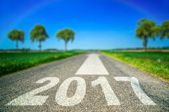 Happy New Year on the road. Happy New Year on the green road Royalty Free Stock Images