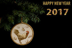 Happy New Year 2017 of rooster card with hand made craft decoupage. Happy New Year 2017 on the Chinese calendar of rooster template card with hand made decoupage Royalty Free Stock Image