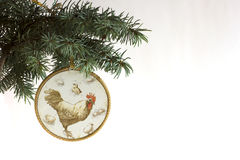 Happy New Year 2017 of rooster card with hand made craft decoupage. Vintage rooster on Christmas tree branch isolated on white background. Copyspace place for Royalty Free Stock Photos