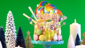 2019 Happy New Year`s candy land lollipop drip cake. stock image
