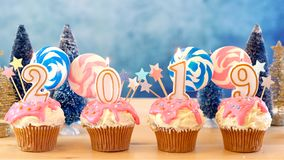 2019 Happy New Year`s candy land lollipop drip cupcakes. royalty free stock images