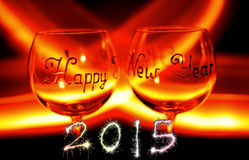 Happy new year`s eve wine glass against fire Stock Photography