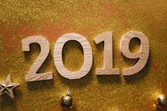 Happy New Year`s layout. numbers 2019 notepad and free space for text. Christmas decorations, xmas toys, gold stars, gifts.  royalty free stock photo