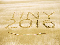 Happy New Year 2016 on sand beach Stock Photo