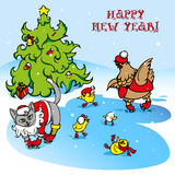 Happy new year. Santa claus cat, chickens and hen skate at the Christmas tree Royalty Free Stock Photos