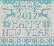 Happy New Year 2017 seamless pattern. Happy New Year 2017 seamless blue pattern. Scandinavian style knitted seamless pattern with deer and snowflakes. Sweater Royalty Free Stock Image