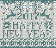 Happy New Year 2017 seamless pattern. Happy New Year 2017 seamless blue pattern. Scandinavian style knitted seamless pattern with deer and snowflakes. Sweater Stock Photography