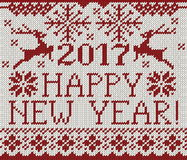 Happy New Year 2017 seamless pattern. Happy New Year 2017 seamless red pattern. Scandinavian style knitted seamless pattern with deer and snowflakes. Sweater Royalty Free Stock Photo