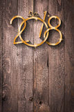 2018 Happy New Year seasonal background with real wood green pine Stock Images