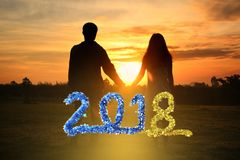 Happy new year 2018 ,Shadow image of couples holding hands with. The morning light.Hand in hand together,selective focus with Lens Flare,silhouette Royalty Free Stock Image