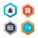 Happy new year sign. Christmas tree and gift box. Hexagon buttons. Happy new year icon. Christmas tree and gift box signs. Fireworks rocket symbol. Labels with Stock Photos