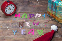 Happy New Year sign of colored letters. Happy New Year, the word on the old wooden background of colored letters Stock Photos