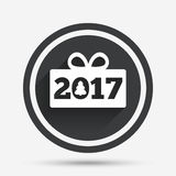 Happy new year 2017 sign icon. Christmas gift. Happy new year 2017 sign icon. Christmas gift anf tree. Circle flat button with shadow and border. Vector royalty free illustration