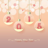 Happy new year 2015. Year 2015 sign in pink color in snow globe hanging on glowing blurry pink gold background Stock Images