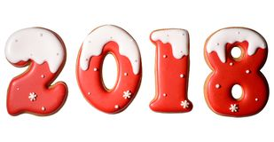 2018 happy new year sign symbol from red and white gingerbread cookies isolated on white background. royalty free stock photography