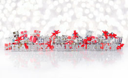 Happy New Year silver text on the background of gifts Royalty Free Stock Images