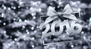 Happy new year 2016 silver text with box and ribbon. In lights glitter background Stock Images