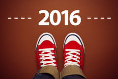 Happy New Year 2016 with Sneakers from Above. Happy New Year 2016 with Person Wearing Red Sneakers from Above, Top View royalty free stock photography
