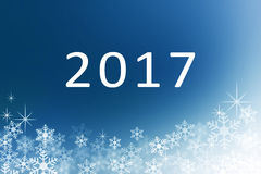 Happy new year 2017 with Snow flakes on midnight blue abstract winter background Stock Photo
