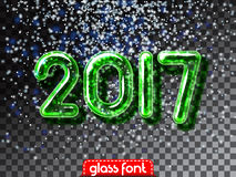 Happy New 2017 Year snowfall invitation. Happy New 2017 Year snowball invitation. Realistic glass font with transparency and shadows. 3D bulb isolated green Royalty Free Stock Image