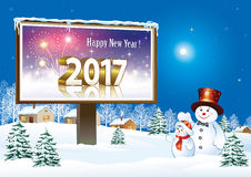 Happy New Year 2017 with snowmen and  billboard Stock Photo