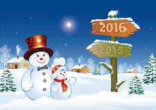 Happy New Year 2016 with snowmen Stock Photos