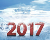 Happy New Year 2017. On snowy mountain background