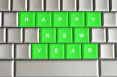 Happy New Year  spelled on a metallic keyboard. Happy New Year spelled on a silver metallic keyboard Royalty Free Stock Photography