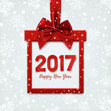 Happy New Year 2017, square banner in form of Christmas gift. Happy New Year 2017, square banner in form of Christmas gift with red ribbon and bow, on winter Royalty Free Stock Photo