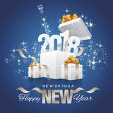 Happy New Year 2018 stardust firework box blue background. Happy New Year 2018 stardust firework sparkle champagne ribbon gift box blue background Royalty Free Stock Images