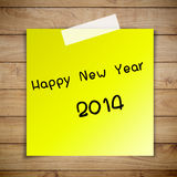 Happy New Year 2014 on sticky paper. On Brown wood plank wall texture background Stock Photo