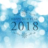 Happy New Year 2018 symbol on blue abstract blur background. Happy New Year 2018 symbol on festive abstract blur background Stock Photography
