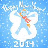 Happy new year 2014!. Symbol of 2014, lying in the snow making a snow angel Stock Image