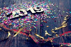 Happy New Year 2019. Symbol from number 2019 on wooden background royalty free stock images