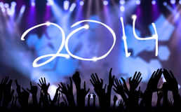 Happy new year 2014. Symbol of happy new year 2014 with silhouette hands Stock Photography