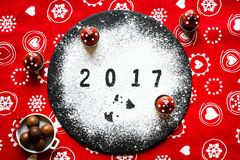 2017 Happy new year table with sugar and chocolate. And christmas decorations Royalty Free Stock Photography