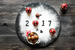 2017 Happy new year table with sugar and chocolate. And christmas decorations Royalty Free Stock Photos