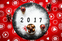 2017 Happy new year table with sugar and chocolate. And christmas decorations Stock Image