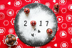 2017 Happy new year table with sugar and chocolate. And christmas decorations Stock Photography