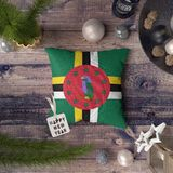Happy New Year tag with Dominica flag on pillow. Christmas decoration concept on wooden table with lovely objects royalty free stock image