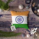 Happy New Year tag with India flag on pillow. Christmas decoration concept on wooden table with lovely objects.  stock photo