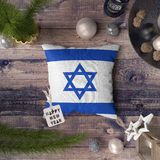 Happy New Year tag with Israel flag on pillow. Christmas decoration concept on wooden table with lovely objects royalty free stock photos