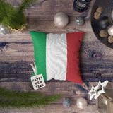 Happy New Year tag with Italy flag on pillow. Christmas decoration concept on wooden table with lovely objects royalty free stock photo