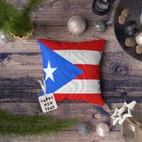 Happy New Year tag with Puerto Rico flag on pillow. Christmas decoration concept on wooden table with lovely objects stock images