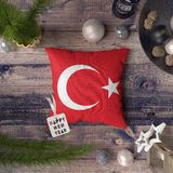 Happy New Year tag with Turkey flag on pillow. Christmas decoration concept on wooden table with lovely objects royalty free stock image