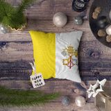 Happy New Year tag with Vatican City Holy See flag on pillow. Christmas decoration concept on wooden table with lovely objects royalty free stock photography